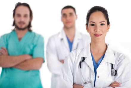 Medical team of Doctors and male nurse, women on front