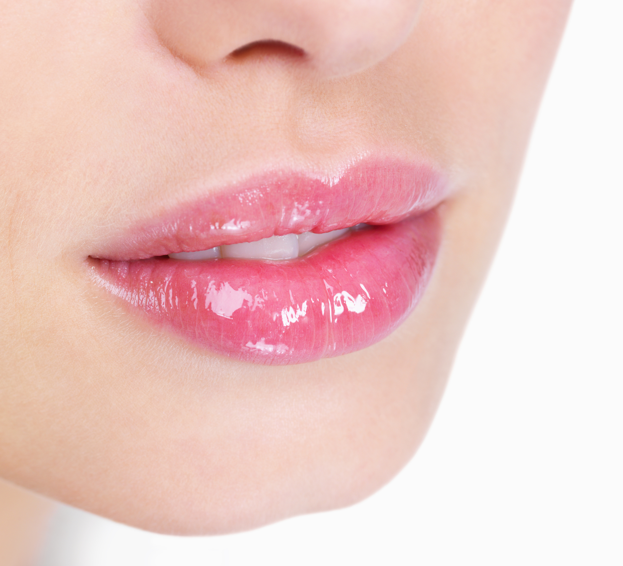 Young woman's glossy pink lips-copyspace